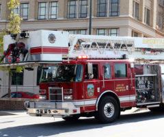 An Asheville firetruck driving through downtown.