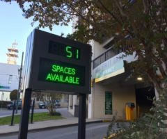 A City of Asheville parking garage entrance showing the number of spaces available.