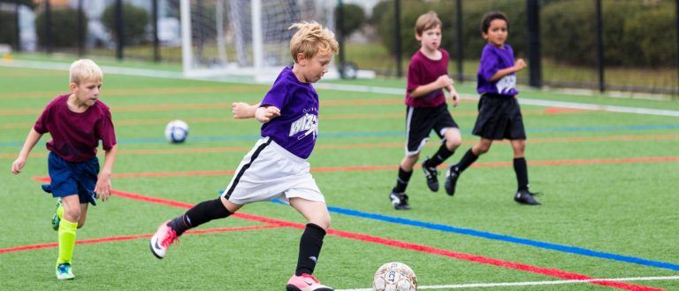A child about to shoot in a soccer game.