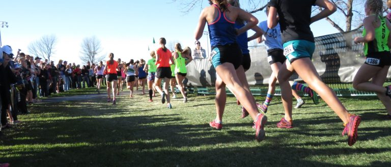 Runners approaching the finish line at a 5k.