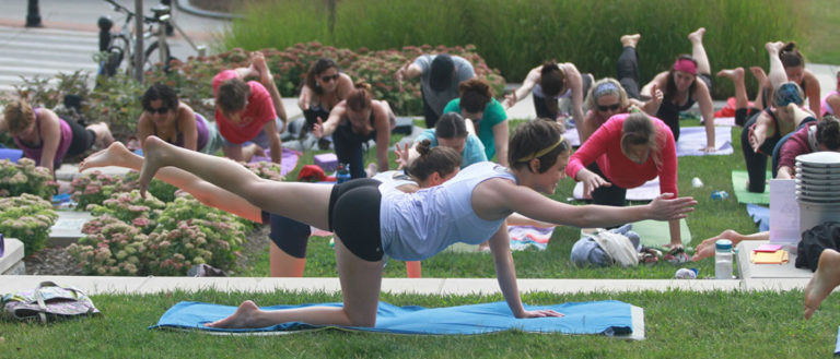People doing yoga at Yoga in the Park in downtown Asheville.