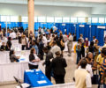 Participants and employers at a jobs fair.