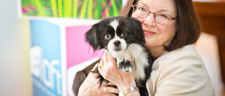 A woman and a dog adopted through Aloft Asheville Downtown's Foster Program.