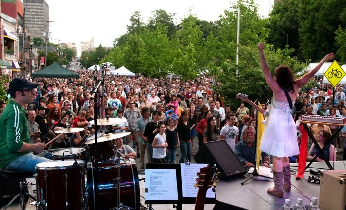 The Downtown After 5 festival featuring a local band and thousands of visitors.