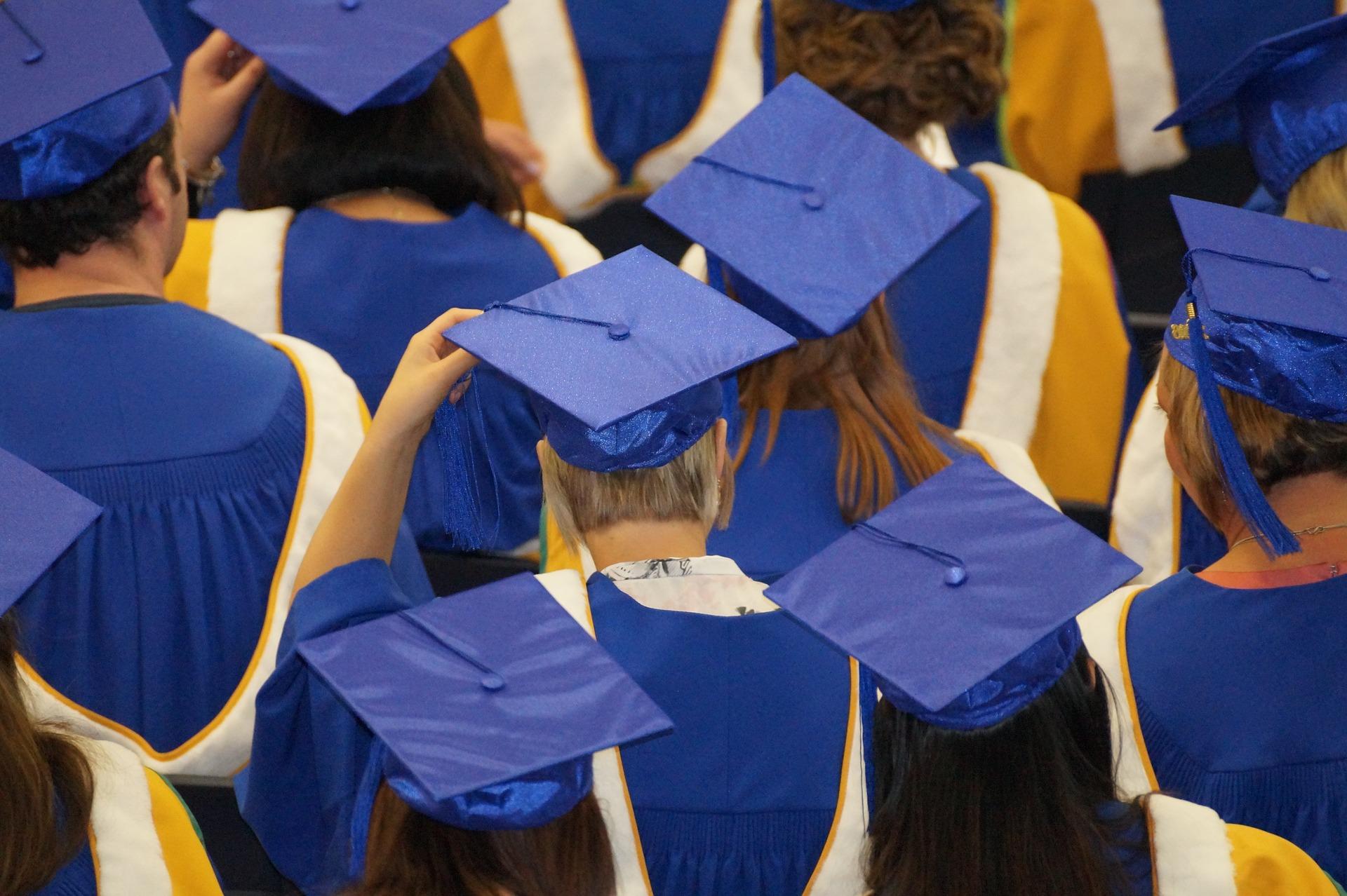 School graduates facing the stage.