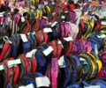Student backpacks filled with school supplies for a donation drive.