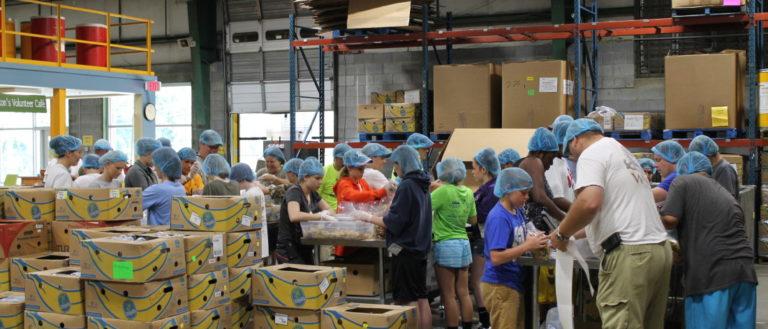Volunteers working in the MANNA FoodBank warehouse.