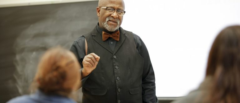 Dr. Dwight Mullen teaching a group of students.