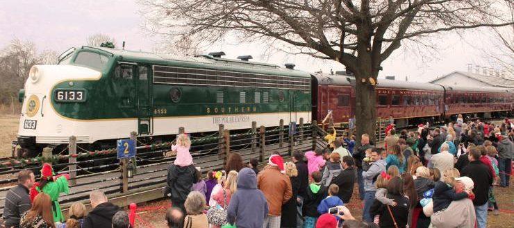 The Polar Express train arriving at a terminal.