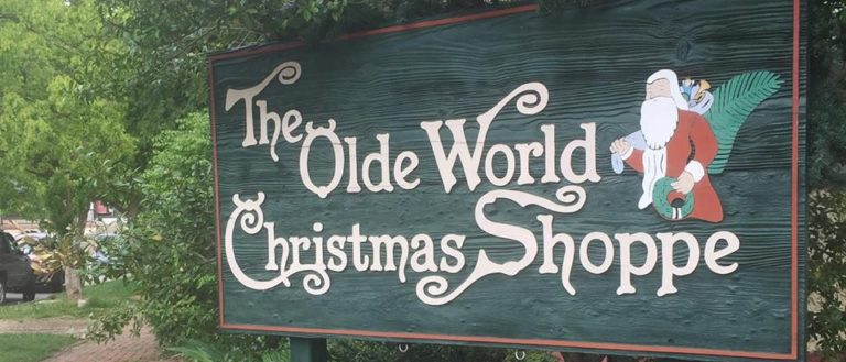 The exterior sign for The Olde World Christmas Shoppe.