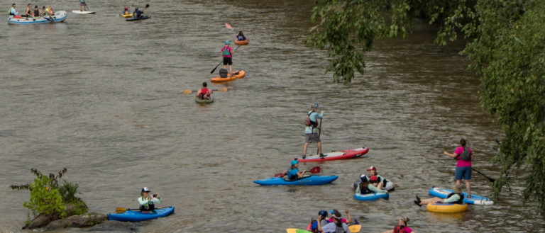 Kayakers on the French Broad River's Blueway.