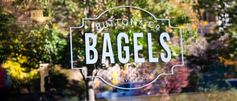A window sign at Button & Co. Bagels.