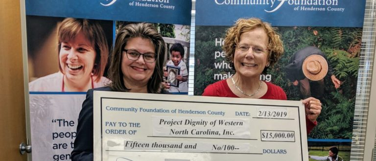 Projecty Dignity receiving a check from Community Foundation of Henderson County.