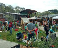 Annual Earth Day Kid's Festival attendees participating in activities and enjoying music at Salvage Station.