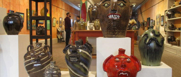 Face jugs on display at the American Folk Art and Framing gallery.