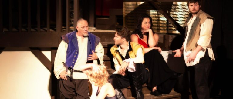 Montford Park Players actors sitting in a cluster in Shakespeare in Love.