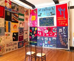 The 2018 AIDS Memorial Quilt on view inside a gallery.