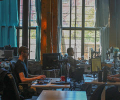 Employees working in the RISC Networks Asheville office.