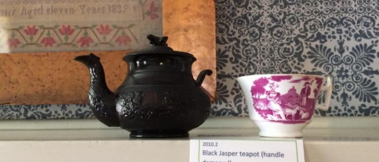 A teapot and teacup at the Infused in History: A Tea Exhibit.